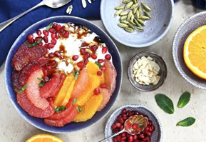 Almond milk and cardamom rice pudding with citrus fruit and pomegranate molasses