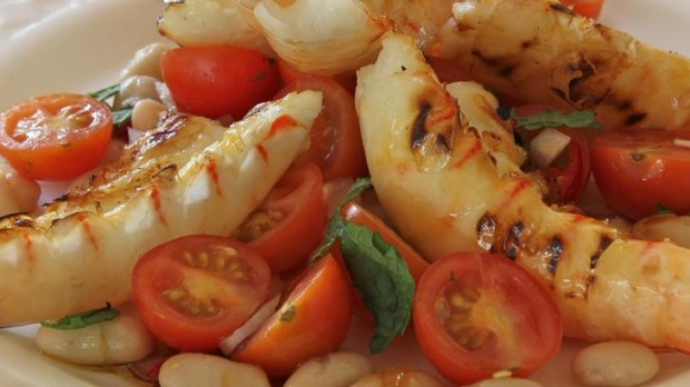 Cherry tomato salad with barbecued prawns